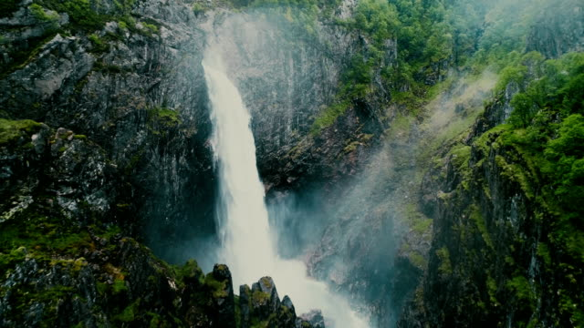 scenic aerial view of voringfossen waterfall and river - power in nature stock videos & royalty-free footage