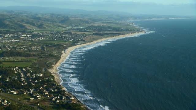 Scenic aerial view over Half Moon Bay coastline in San Mateo County, California.