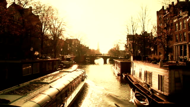 Scenic Amsterdam Canal Scene at Sunset