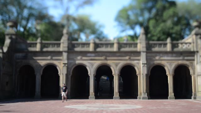 Scenic and beauty shots of Central Park in New York NY Wide shots of commuters visitors and tourists walking through the archways of Bethesda Terrace...