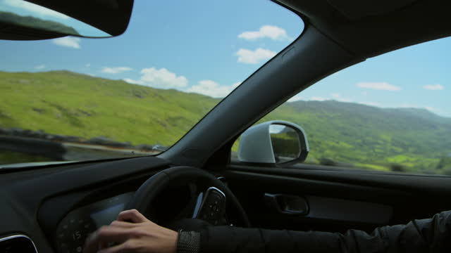 scenic driving on road trip in lush countryside and mountains of snowdonia national park - inside car pov point of view angle - fordon på land bildbanksvideor och videomaterial från bakom kulisserna