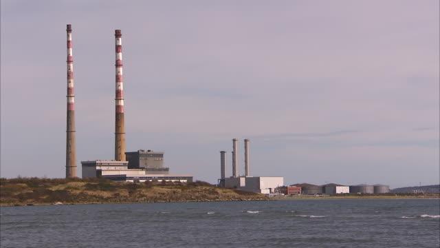 scenic factory shot in ireland - bottich stock-videos und b-roll-filmmaterial