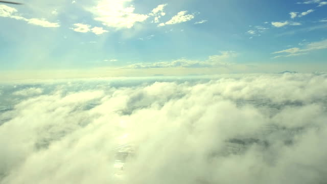 scenic flight above the clouds towards the sun - soft cloud sky stock videos & royalty-free footage