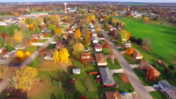 Scenic Flyover of Small Town USA in Autumn
