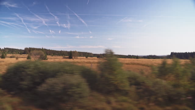 scenic landscape against sky - moving past stock videos & royalty-free footage