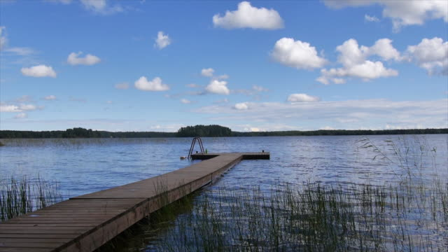 a scenic landscape view of a lake and dock. - slow motion - finlandia video stock e b–roll