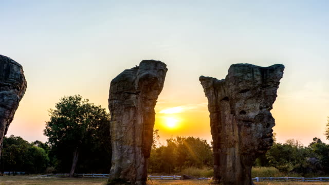scenic landscape view of stonehenge at sunrise, mor hin khao, chaiyaphim, thailand - gravestone stock videos & royalty-free footage
