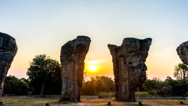 t/l tu scenic landscape view of stonehenge at sunrise, mor hin khao, chaiyaphim, thailand - paganism stock videos and b-roll footage