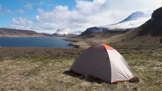 Scenic landscape with tent near a seashore in Iceland