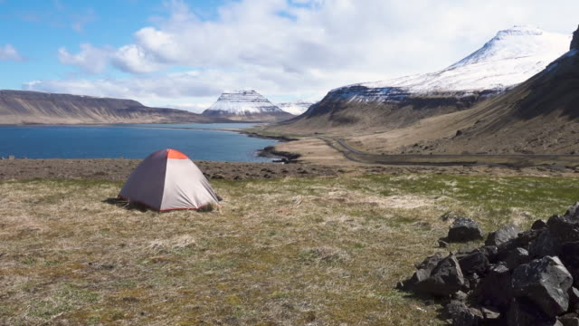 Scenic landscape with tent near seashore in Iceland