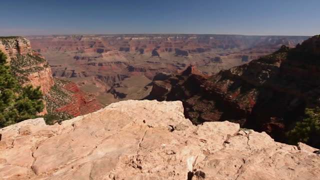scenic overlook of grand canyon from the rim looking down to the deep valley below - grand canyon stock videos and b-roll footage