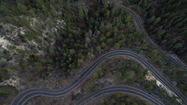 scenic serpentine highway 89a between sedona and flagstaff, arizona, in the twilight. aerial drone looking-down video with the tilting-up camera motion. - sedona stock videos & royalty-free footage