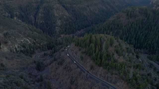 scenic serpentine highway 89a between sedona and flagstaff, arizona, in the twilight. aerial drone video with the backward camera motion. - evergreen tree stock videos & royalty-free footage