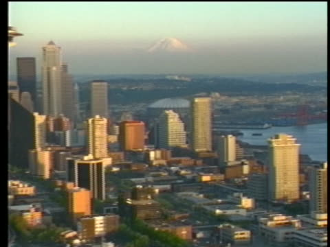 scenic shot from 1989 of mount rainer and downtown seattle with a view of the space needle. - seattle stock videos & royalty-free footage