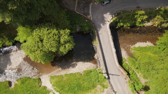 scenic stone bridge, exmoor national park aerial - exmoor national park stock videos & royalty-free footage
