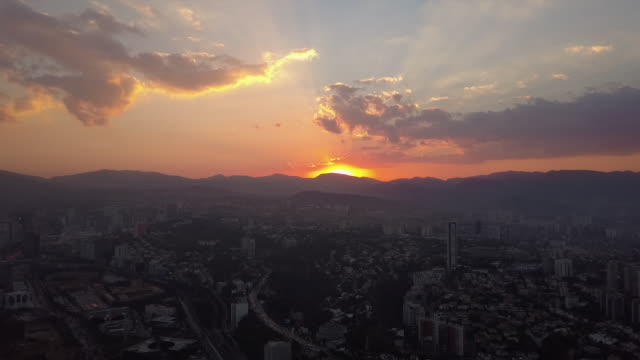 Scenic sunset over Mexico City cityscape, wide aerial