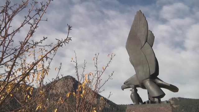 Scenic time lapse shots from around the Terrazzo at the Air Force Academy Includes a bronze statue of Brigadier General James Risner the...