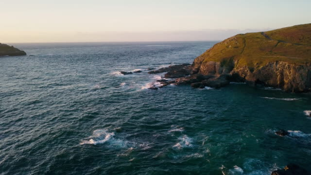 scenic view flying above cornwall coastline landscapes - 4k - rocky coastline stock videos & royalty-free footage
