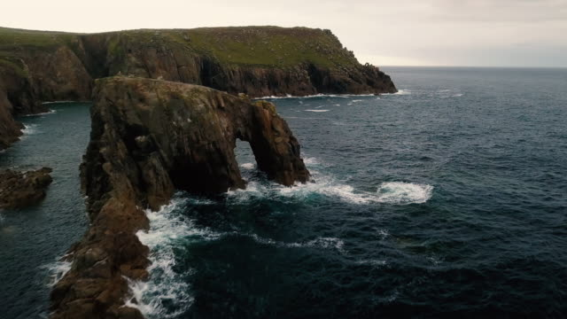 scenic view flying above cornwall coastline landscapes - 4k - lands end cornwall stock videos and b-roll footage