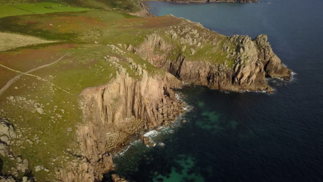 scenic view flying above cornwall coastline landscapes - 4k - inghilterra video stock e b–roll