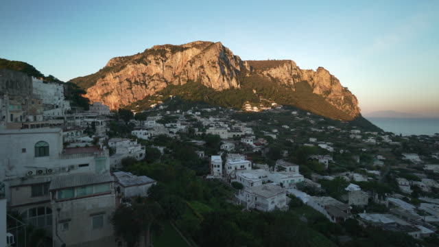 scenic view in town on island of capri in italy at sunset - ナポリ点の映像素材/bロール