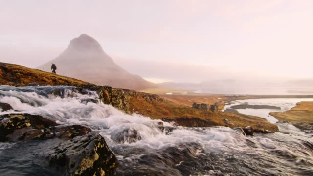ws scenic view kirkjufell mountain and kirkjufellsfoss waterfall,iceland - iceland stock videos & royalty-free footage
