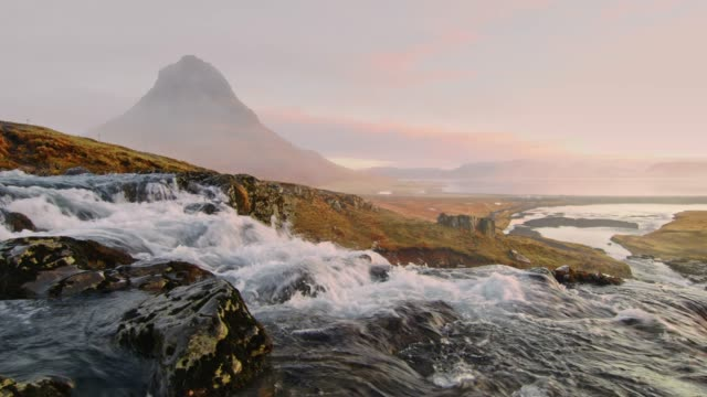 ws scenic view kirkjufell mountain and kirkjufellsfoss waterfall,iceland - remote location stock videos & royalty-free footage