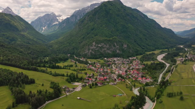 ws scenic view mountains and valley town, kranjska gora. - mountain range stock videos & royalty-free footage