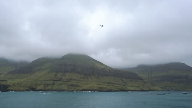 scenic view of airplane above  the sea  on  faroe islands - atlantic islands stock videos & royalty-free footage