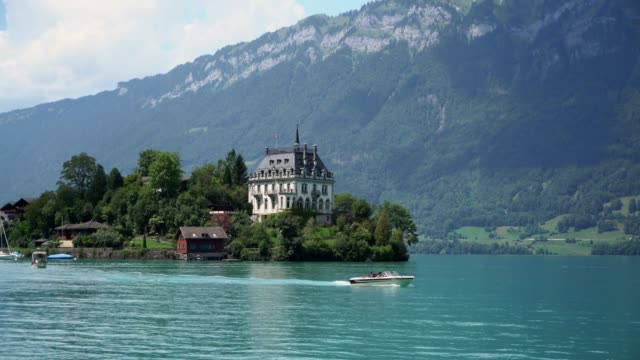 scenic view of boat on interlaken lake in switzerland - switzerland stock videos & royalty-free footage