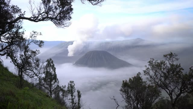scenic view of bromo volcano at sunrise in fog - mount semeru stock videos & royalty-free footage