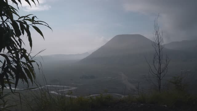 scenic view of bromo volcano at sunrise in fog - atmospheric mood stock videos & royalty-free footage
