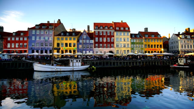 scenic view of famous nyhavn pier in the old town of copenhagen - copenhagen video stock e b–roll