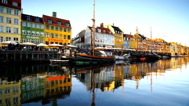 scenic view of famous nyhavn pier in the old town of copenhagen - copenhagen stock videos & royalty-free footage