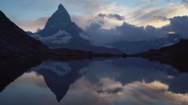 scenic view of lake in matterhorn - alpi video stock e b–roll