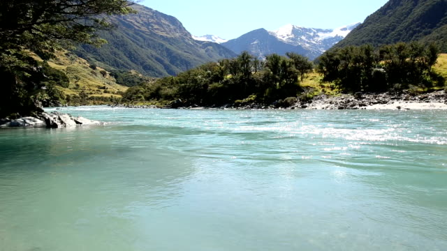 scenic view of mountain river to glaciated mountains - flowing water stock videos & royalty-free footage