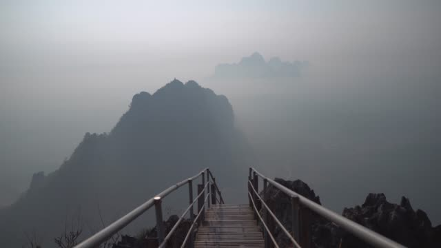 scenic view of mountains in fog in  hpa an from above - cliff stock videos & royalty-free footage