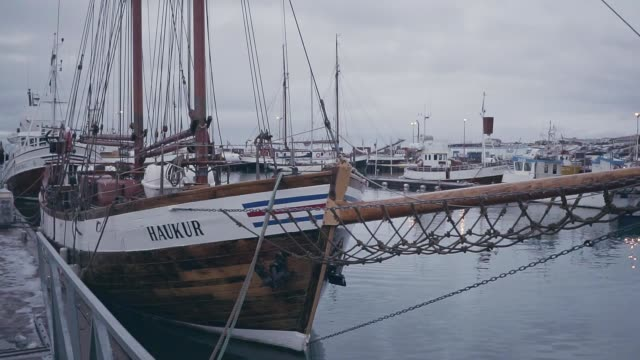 Scenic view of port with old ships in Husavik, in winter