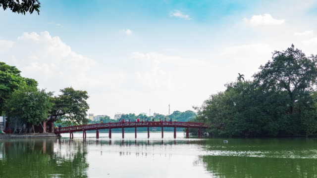scenic view of red bridge and blue sky, huc bridge on hoan kiem lake, hanoi, vietnam, time lapse video - hanoi stock videos and b-roll footage
