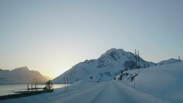 scenic view of road on lofoten islands in winter from car - land vehicle stock videos & royalty-free footage