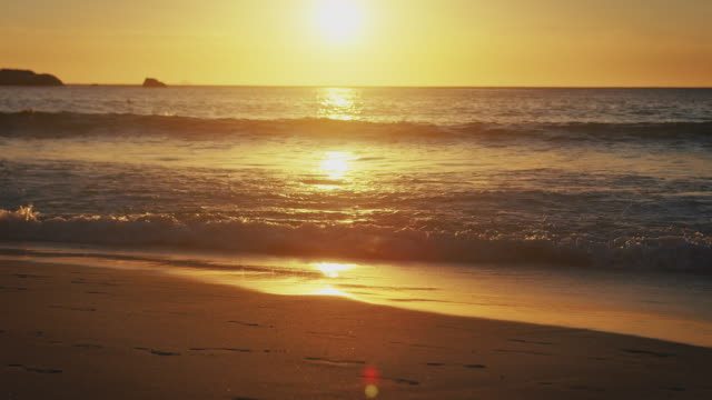 scenic view of sea waves at beach during sunset - strand south africa stock videos & royalty-free footage