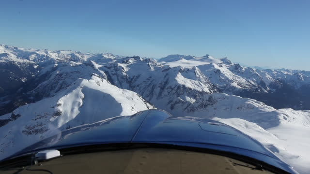 Scenic view of snow covered mountain from front of airplane