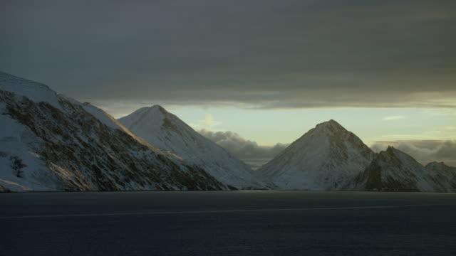 Scenic View Of Snowy Coastal Mountains