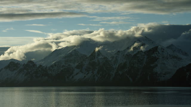 Scenic View Of Snowy Mountains On Coast