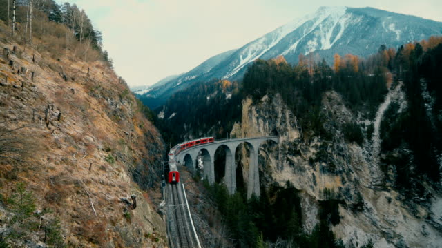 scenic  view of train on  landwasser viaduct in switzerland - alpi video stock e b–roll