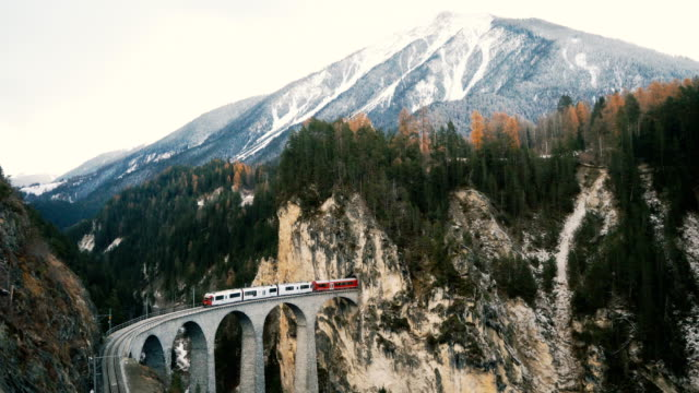 scenic  view of train on  landwasser viaduct in switzerland - viewpoint stock videos & royalty-free footage