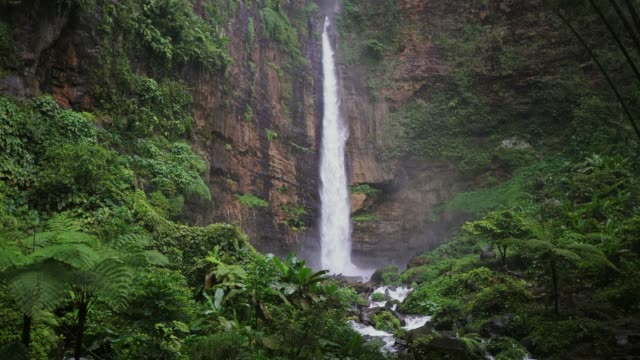 scenic view of waterfall on java - atmospheric mood stock videos & royalty-free footage