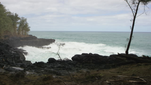 Scenic view of waves crashing into cove