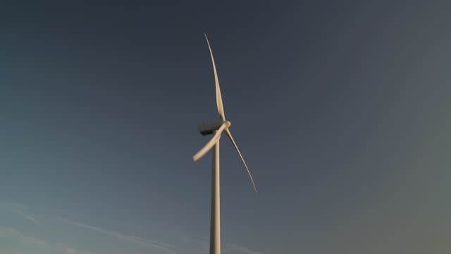 scenic view of wind turbine in motion, rural setting - wind power stock videos & royalty-free footage