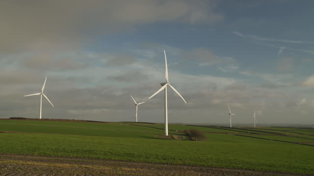 scenic view of wind turbines in motion, rural setting - less than 10 seconds stock videos & royalty-free footage